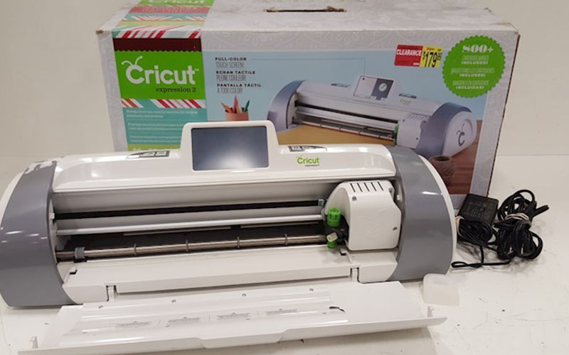 Cricut Explore Air 2 die cutting machine with a box